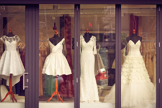 Wedding dress shop showing a selection of dresses