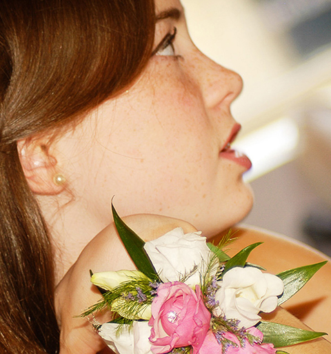 closeup of bridesmaid intently watching ceremony